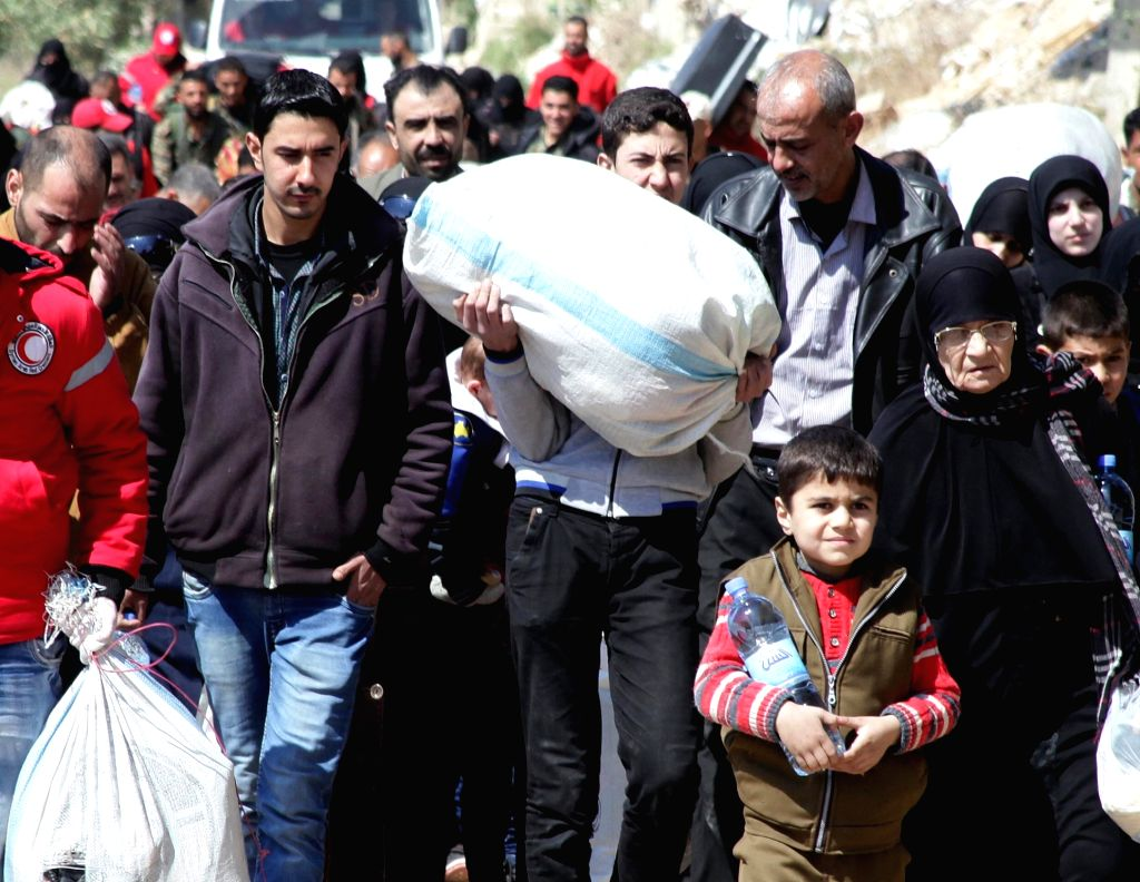 DAMASCUS, March 31, 2018 - Syrians evacuate from rebel-held areas in Eastern Ghouta, countryside of the capital Damascus, March 31, 2018. The evacuation of the rebels and their families as well as ...