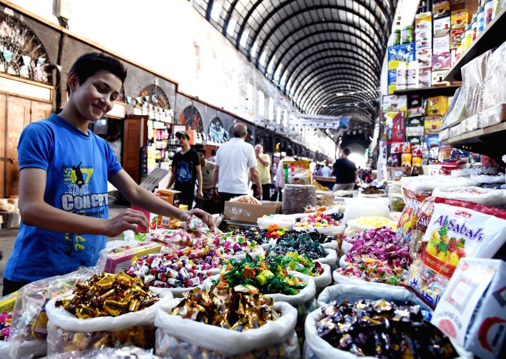 DAMASCUS, May 20, 2019 - People buy candies on the occasion of the Muslim holy month of Ramadan at a marketplace in Damascus, Syria, May 19, 2019.
