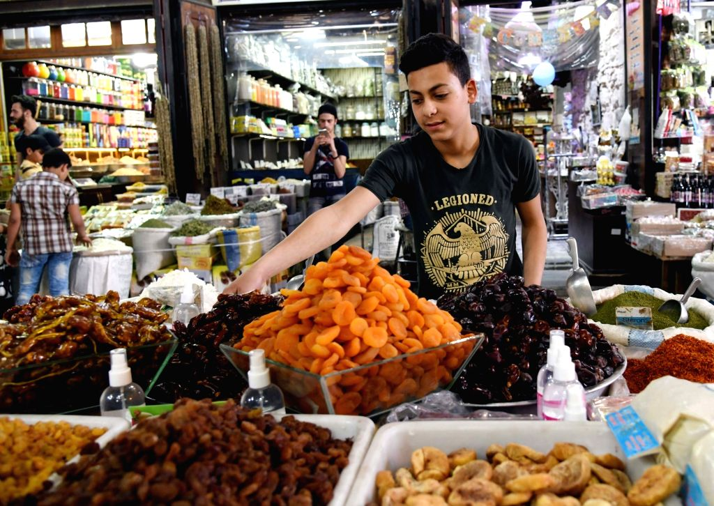 DAMASCUS, May 20, 2019 - People buy dried fruits on the occasion of the Muslim holy month of Ramadan at a marketplace in Damascus, Syria, May 19, 2019.