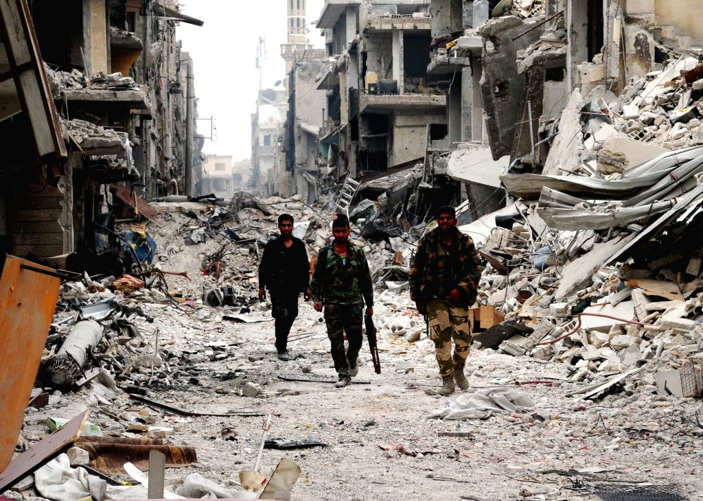 DAMASCUS, May 22, 2018 - Syrian soldiers are seen in the largely destroyed Hajar al-Aswad district, south of Damascus, Syria, on May 22, 2018, a day after it was declared free of the Islamic State ...