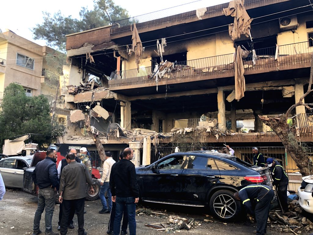 DAMASCUS, Nov. 12, 2019 - Photo taken with a phone shows people gathering at the missile attack scene in Al-Mazzeh area of Syria's capital Damascus on Nov. 12, 2019. An Israeli missile attack ...