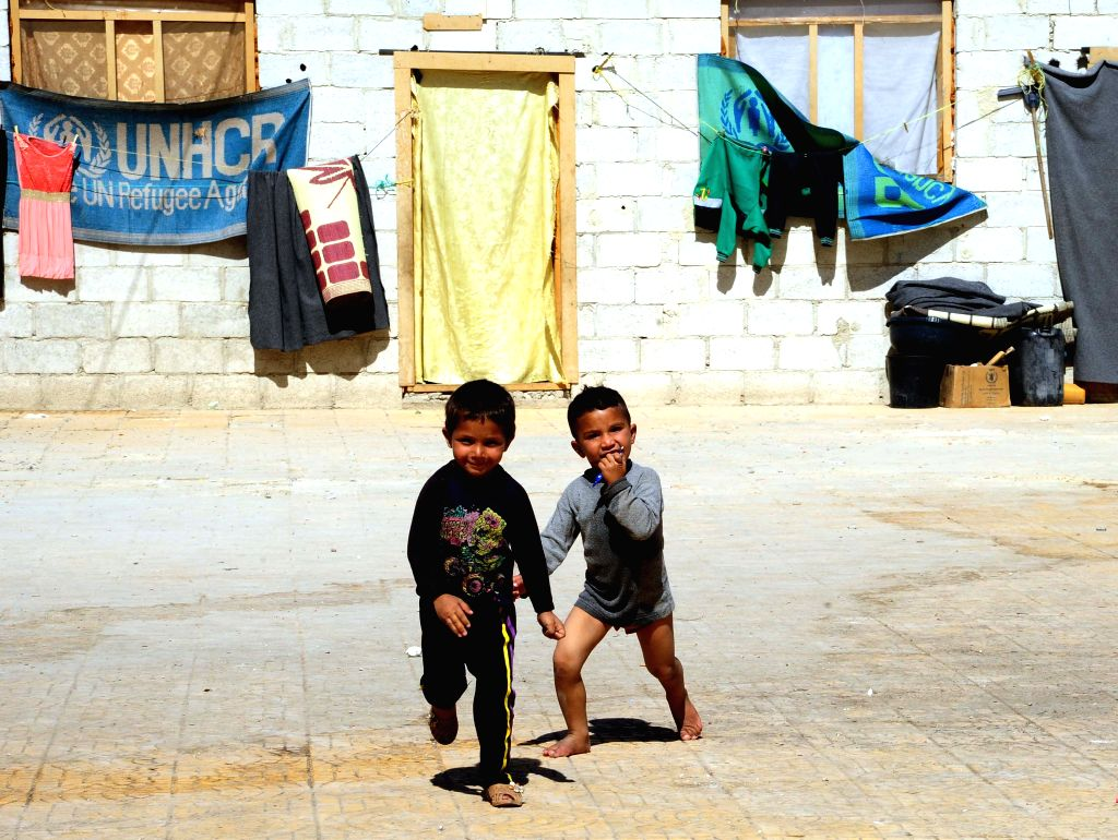 DAMASCUS, Oct. 15, 2016 - Syrian kids play at a yard in a displacement center in the town of Hirjalleh, countryside of Damascus, capital of Syria, on Oct.15, 2016. The Hirjalleh displacement shelter ...