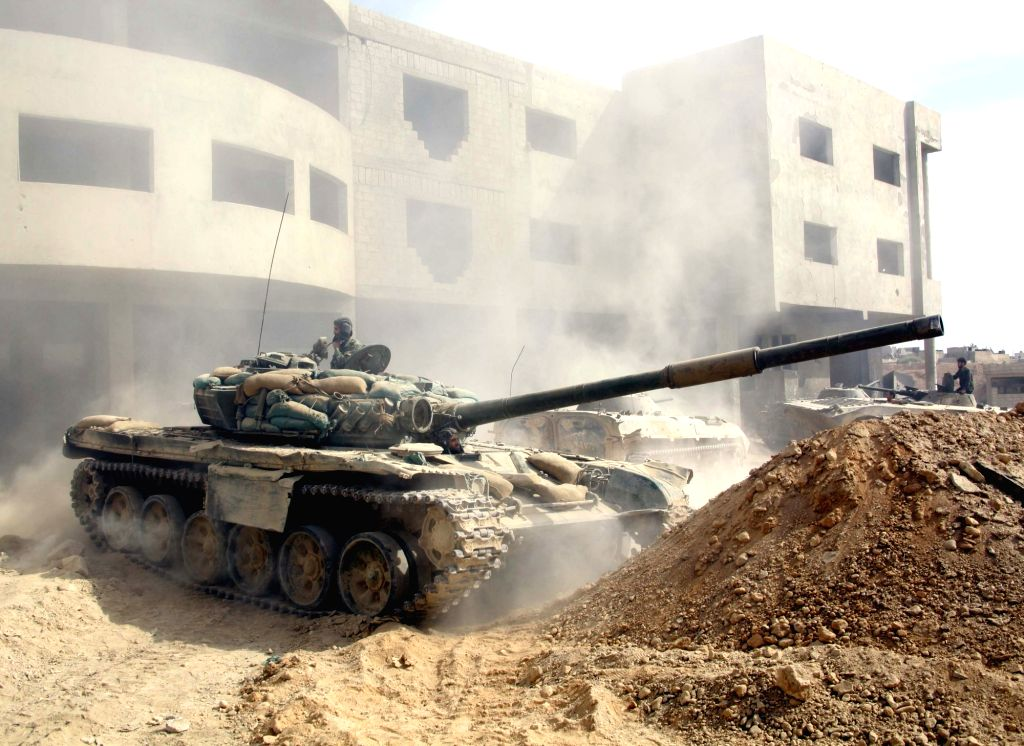DAMASCUS, Oct. 21, 2016 - A Syrian tank fires at rebel positions in the Jobar area, east of Damascus, capital of Syria, on Oct. 21, 2016. The Syrian army foiled an attack by the armed rebels on the ...