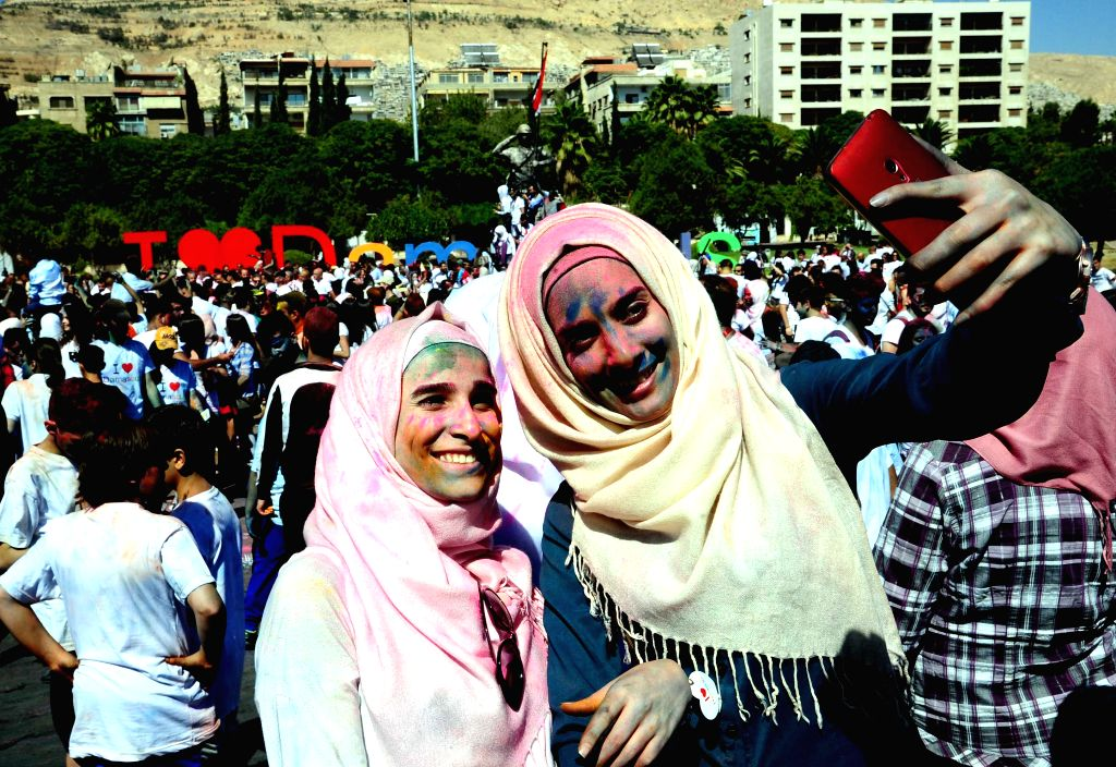 "DAMASCUS, Oct. 8, 2016 - Two women pose for a selfie during a marathon dubbed ""I Love Damascus"" held in Damascus, capital of Syria, on Oct. 7, 2016. Nearly 2,000 people took part in the ..."