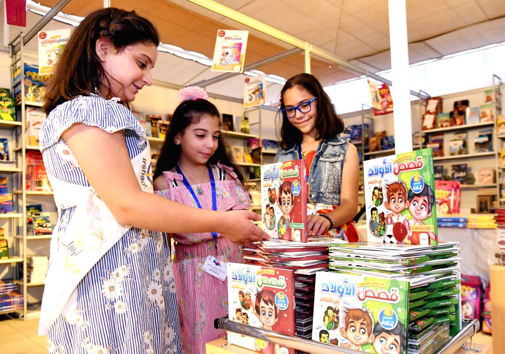 DAMASCUS, Sept. 13, 2019 - People visit the 31st book fair at the Al-Assad Library in Damascus, capital of Syria, on Sept. 12, 2019. More than 235 publishing houses from Syria, Lebanon, Iraq, Egypt, ...