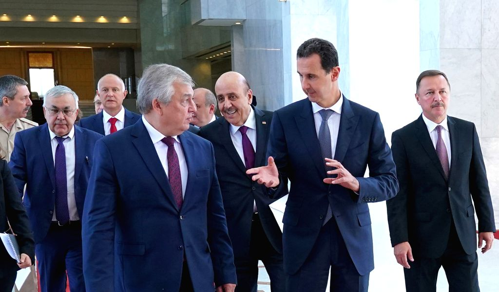 DAMASCUS, Sept. 15, 2019 - Syrian President Bashar al-Assad (R, Front) speaks with Russian president's Special Envoy to Syria Alexander Lavrentiev (L, Front) in Damascus, Syria, on Sept. 15, 2019. ...