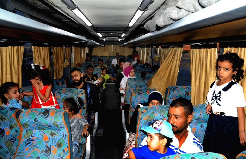 DAMASCUS, Sept. 18, 2018 - Syrian refugees from Lebanon are seen in a bus transporting them back to Syria at Syria's Jdaidet Yabous border point in Damascus, Syria, on Sept. 17, 2018. A new batch of ...