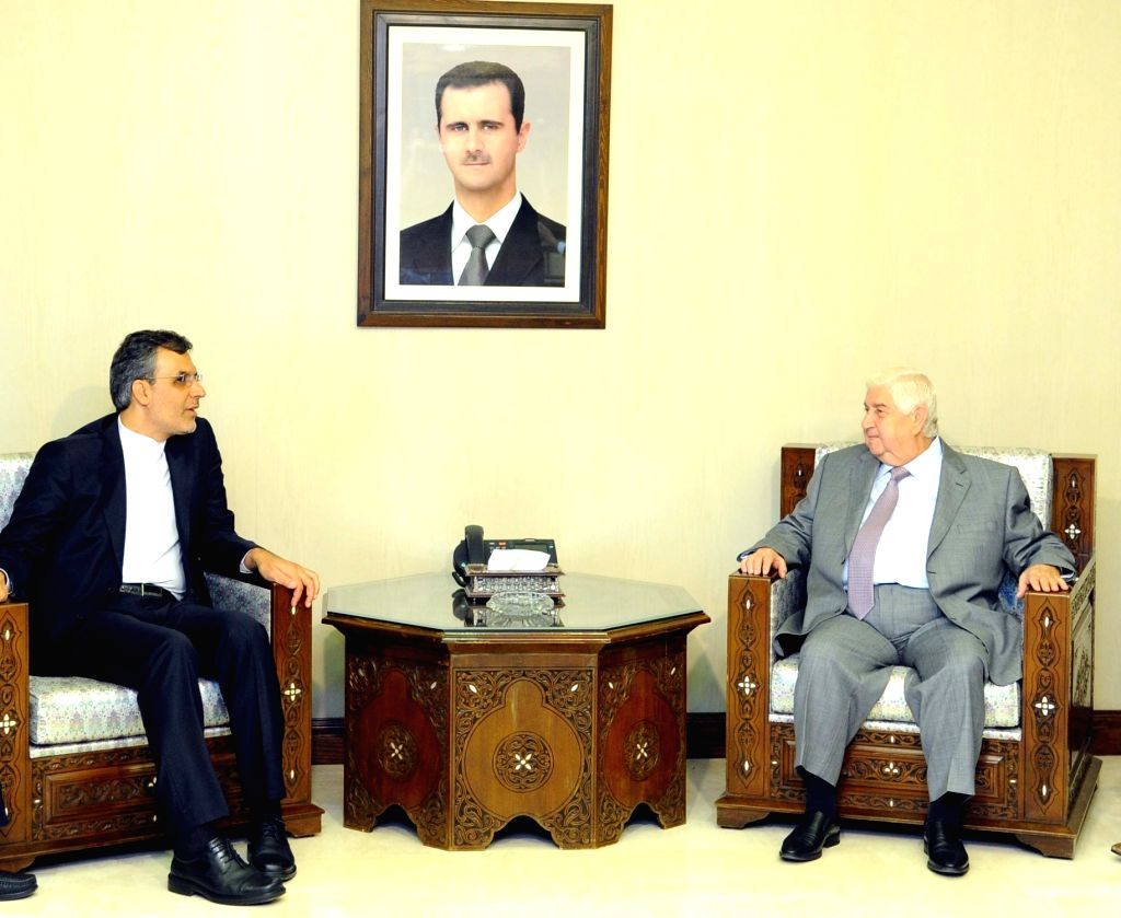 DAMASCUS, Sept. 19, 2016 - Syrian Foreign Minister Walid al-Moallem(R) meets with the visiting Iranian Deputy Foreign Minister for Arab-African Affairs Hossein Jaberi Ansari in Damascus, capital of ... - Walid
