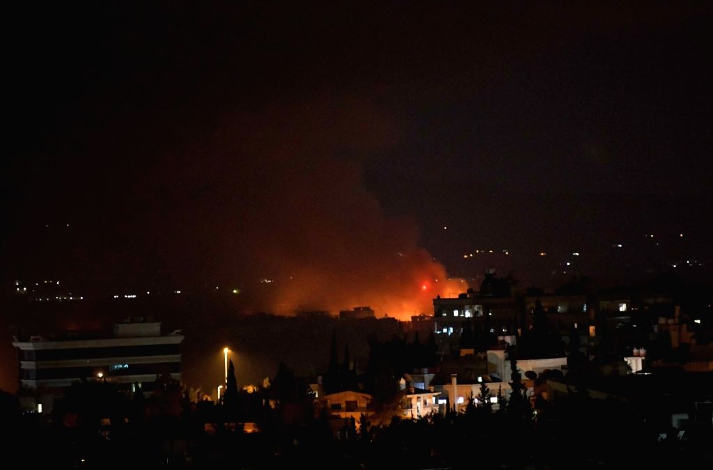 DAMASCUS, Sept. 2, 2018 - Photo taken on Sept. 2, 2018 shows the fire and smoke rising from the Mazzeh airbase in the Damascus' western Mazzeh neighborhood, Syria, on Sept. 2, 2018. The Syrian army ...