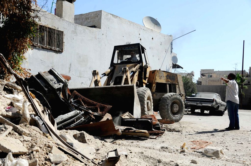 DAMASCUS, Sept. 27, 2019 - A bulldozer removes rubble from the neighborhood of al-Qadam in Damascus, Syria, on Sept. 26, 2019. The Syrian government started removing rubble from previously rebel-held ...
