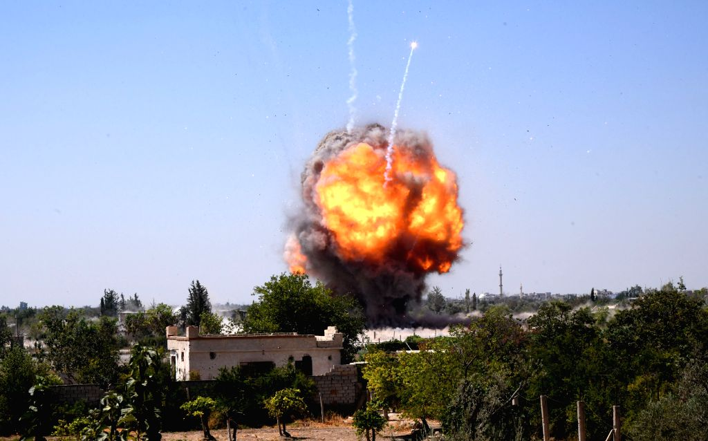 DAMASCUS, Sept. 3, 2019 - Fire is seen after the army detonated bombs left by the rebels in agricultural areas in the Eastern Ghouta countryside of Damascus, Syria, on Sept. 3, 2019. The Syrian ...