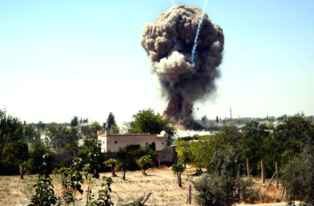 DAMASCUS, Sept. 3, 2019 - Smoke is seen after the army detonated bombs left by the rebels in agricultural areas in the Eastern Ghouta countryside of Damascus, Syria, on Sept. 3, 2019. The Syrian ...
