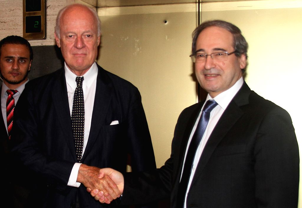 Syrian Deputy Foreign Minister Faisal al-Miqdad (R) shakes hands with Staffan de Mistura, the new UN envoy to Syria, in Damascus, Syria on Sept. 9, 2014. The newly - Faisal