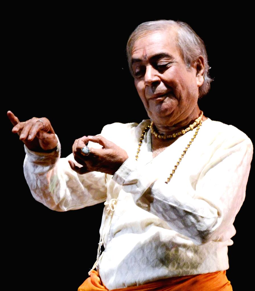Dance maestro Pandit Birju Maharaj and his troupe performing during a programme in Patna on Dec. 7, 2013. (Photo: IANS)