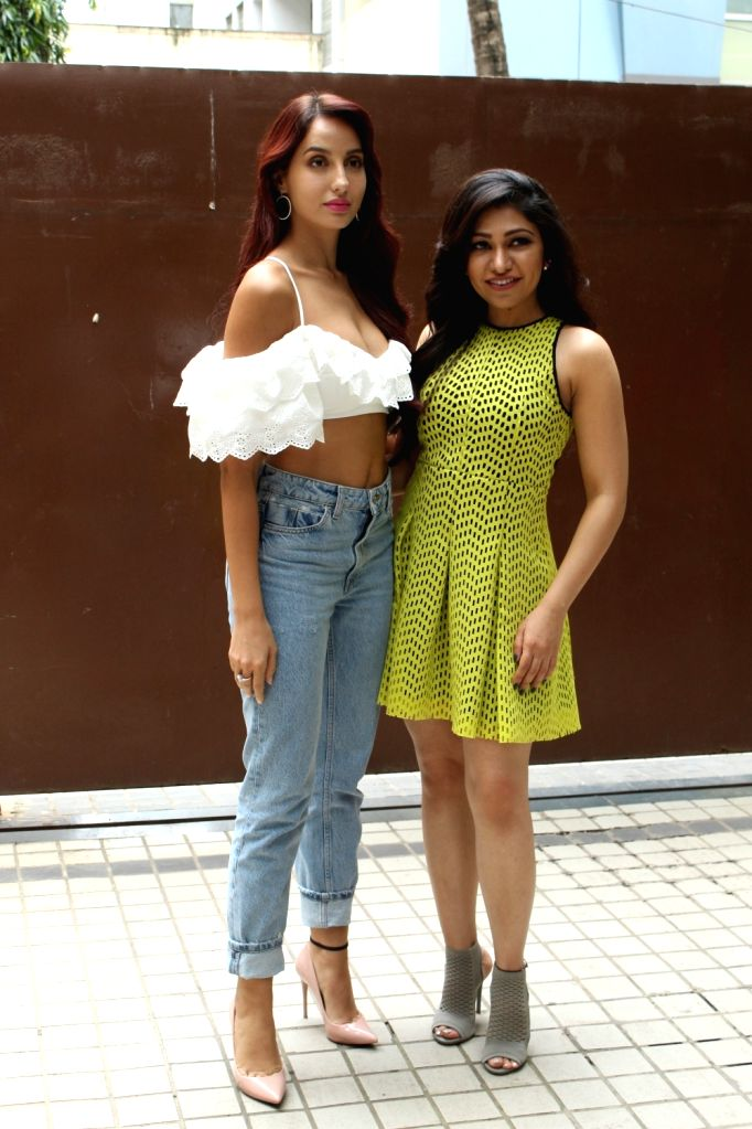 "Dancer-actress Nora Fatehi with singer Tulsi Kumar during the promotion of her upcoming film ""Batla House"" in Mumbai, on July 17, 2019. - Nora Fatehi and Tulsi Kumar"