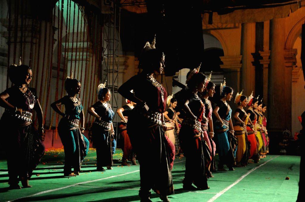 Dancers of Dona Ganguly's group 'Diksha Manjari' perform during the Basanta Utsav in Kolkata on March 10, 2017.