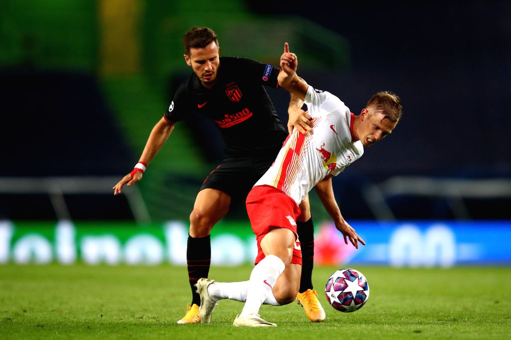 Dani Olmo (R) of RB Leipzig vies with Saul Niguez of Atletico Madrid during the 2019-2020 UEFA Champions League quarter final match between RB Leipzig and Atletico ...