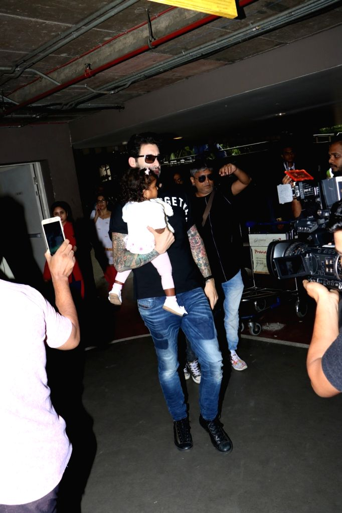 Daniel Weber with his daughter Nisha Kaur Weber at Chhatrapati Shivaji Maharaj International airport in Mumbai on Sept 18, 2017. - Nisha Kaur Weber
