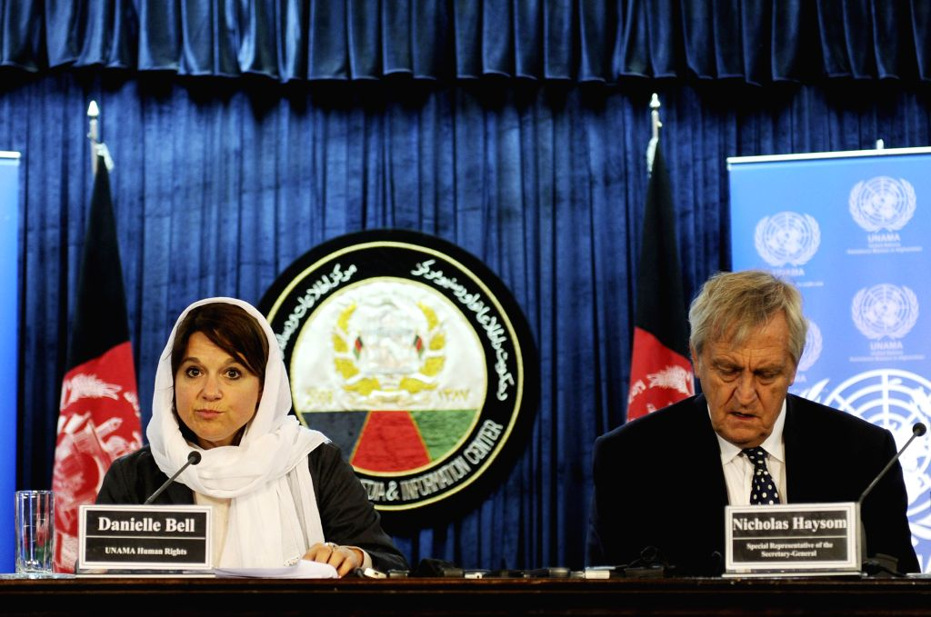 Danielle Bell, director of the Human Rights Unit at the United Nations Assistance Mission in Afghanistan (L),  speaks during a press conference in Kabul, Afghanistan, ...