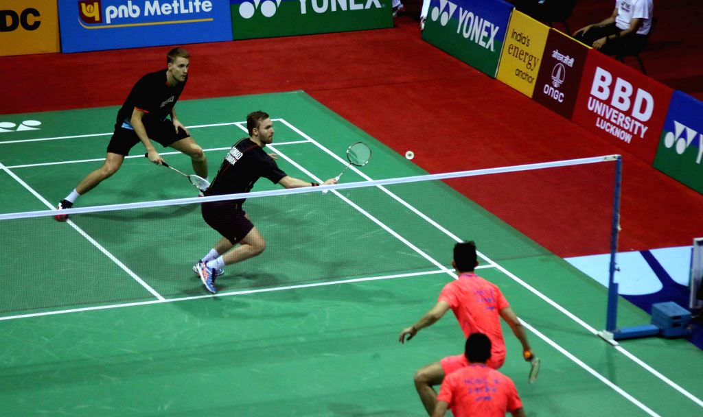 Danish badminton players Mads Pieler Kolding and Mads Conrad-Petersen in action against their Chinese counterpart Chai Biao and Hong Wei during a match of Yonex Sunrise Indian Open Badminton ...