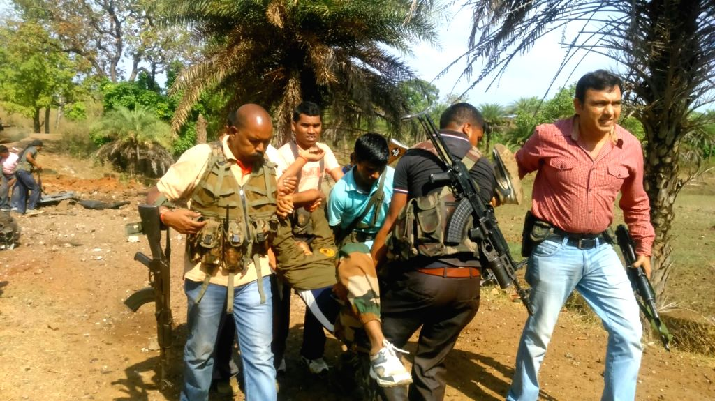 Security personnel take a soldier injured in a blast triggered by Maoists in Chhattisgarh's Dantewada district for treatment on April 13, 2015.