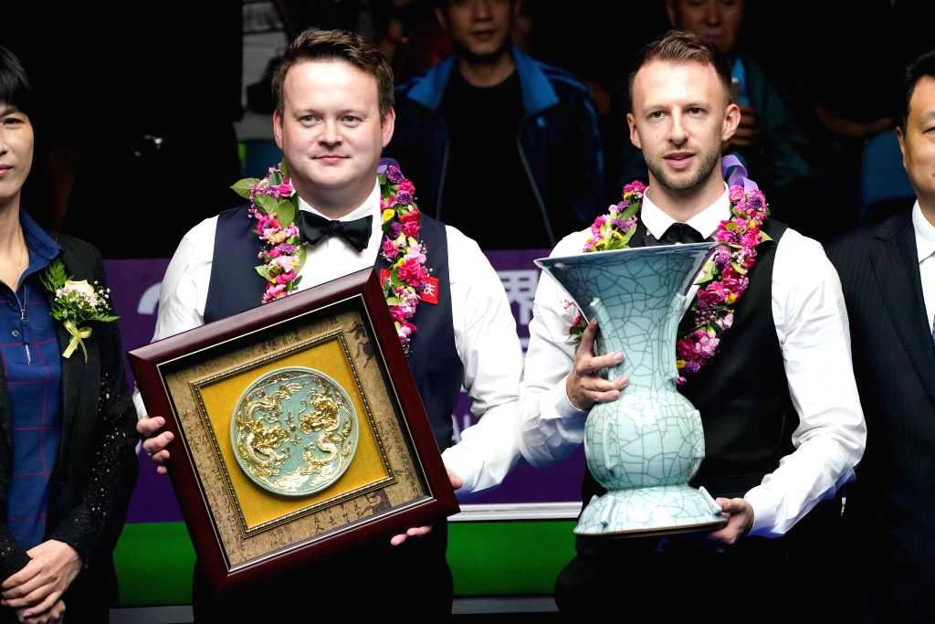DAQING, Aug. 11, 2019 - Judd Trump (R) of England poses with his compatriot Shaun Murphy during the awarding ceremony at 2019 World Snooker International Championship in Daqing, northeast China's ...