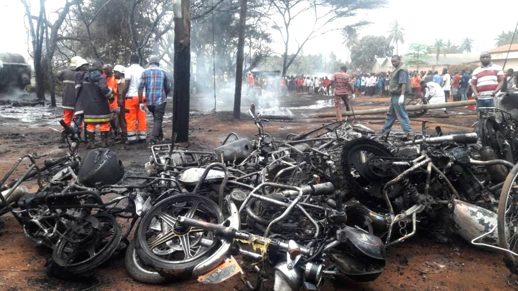 DAR ES SALAAM, Aug. 10, 2019 (Xinhua) -- Photo taken on Aug. 10, 2019 shows the accident scene after a petrol tanker exploded in Morogoro Region, Tanzania. At least 60 people were killed Saturday after an overturned petrol tanker exploded in Morogoro