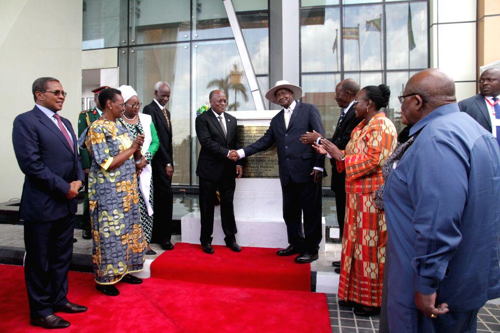 DAR ES SALAAM, Sept. 6, 2019 - Tanzanian President John Magufuli (C-L) and Ugandan President Yoweri Museveni (C-R) attend the inauguration ceremony of a building built by China Railway Construction ...