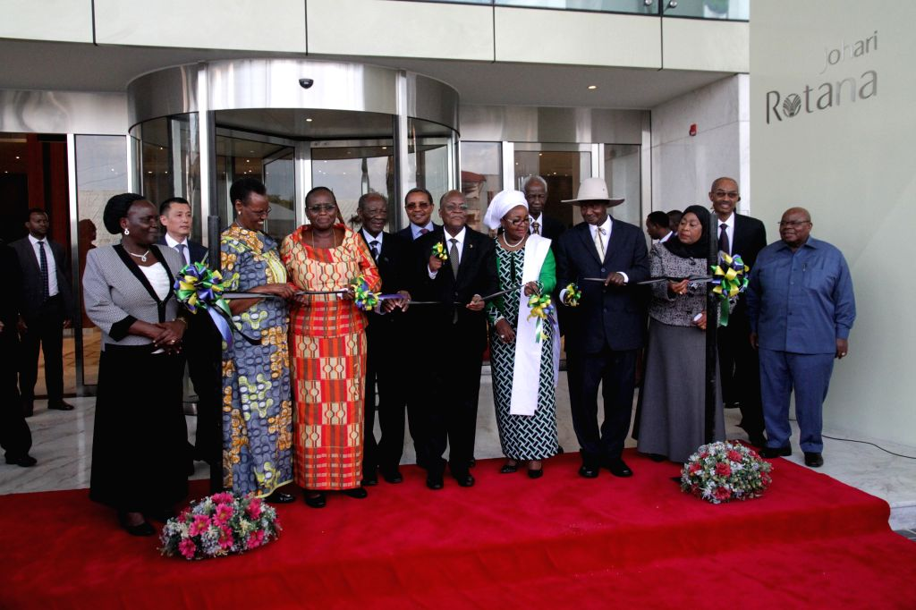 DAR ES SALAAM, Sept. 6, 2019 - Tanzanian President John Magufuli (4th L, Front) and Ugandan President Yoweri Museveni (3rd R, Front) cut a ribbon at the inauguration ceremony of a building built by ...
