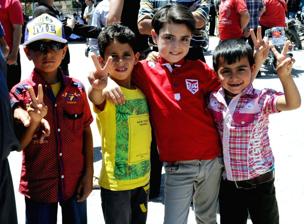 DARAA, July 2, 2018 - Children flash victory signs during a celebration for the entry of the Syrian army to the town of Dael in the countryside of the southern province of Daraa, Syria, on July 1, ...