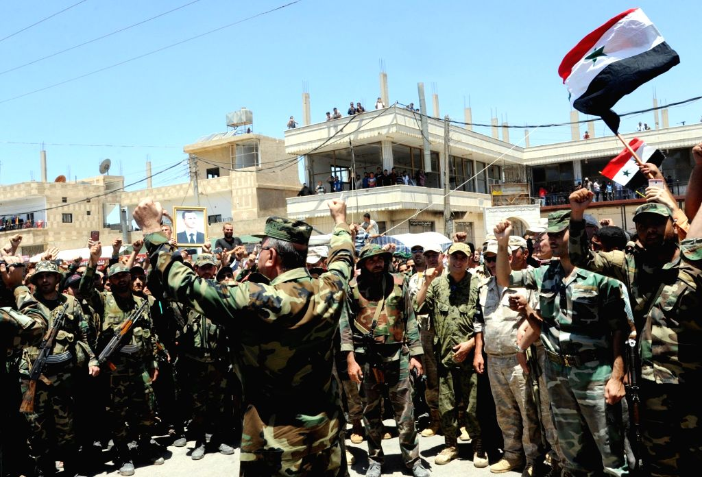 DARAA, July 2, 2018 - Syrian soldiers celebrate victory after entering the town of Dael in the countryside of the southern province of Daraa, Syria, on July 1, 2018. The Syrian army entered Dael ...