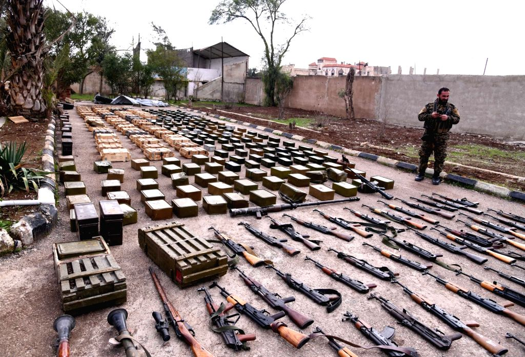DARAA (SYRIA), Dec. 12, 2018 Confiscated weapons and ammunition are seen at a military base in Syria's southern province of Daraa, on Dec. 12, 2018. The Syrian army found various weapons ...