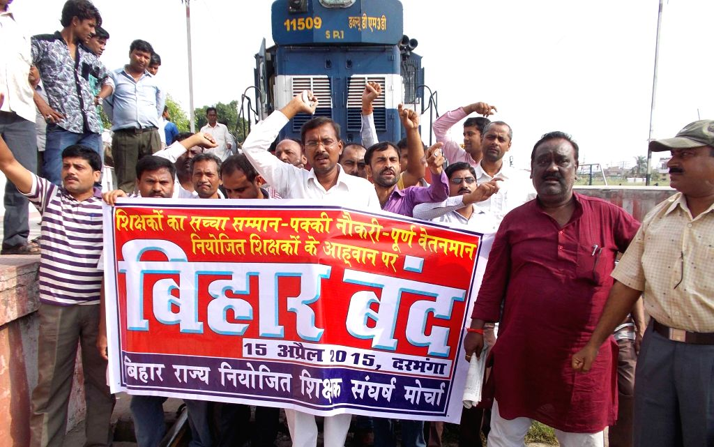 Teachers stage a demonstration on railway tracks to press for their demands in Darbhanga of Bihar in on April 15, 2015.