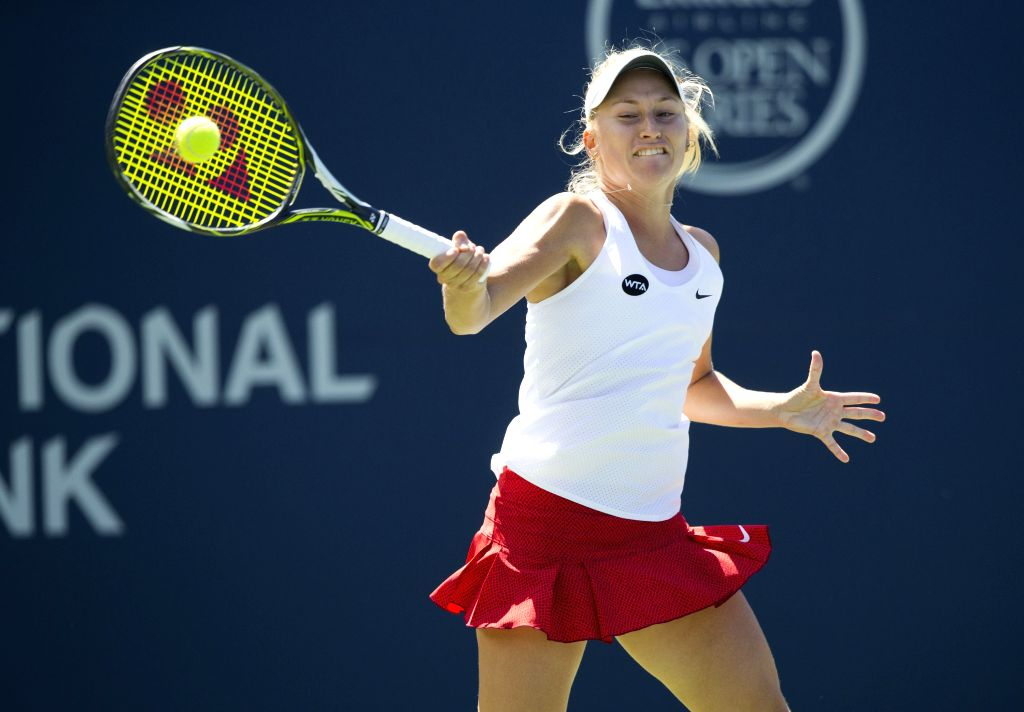Daria Gavrilova of Russia hits a return during the women's singles 2nd round match against Lucie Safarova of the Czech Republic at the 2015 Rogers Cup in Toronto, ...