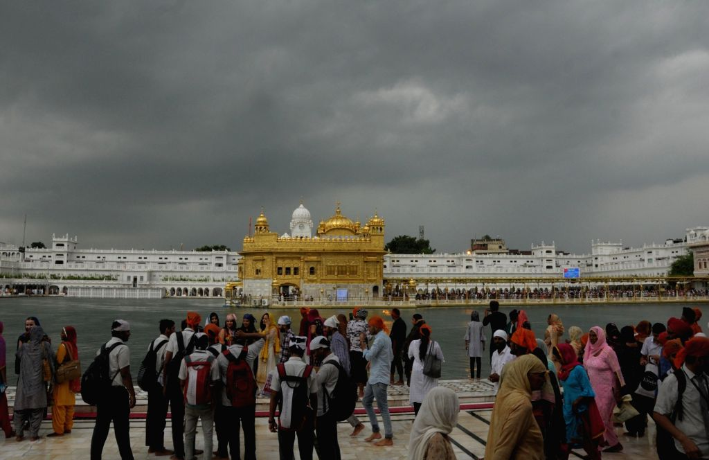 Dark clouds hover over the Golden Temple on an overcast day, in Amritsar on Sep 28, 2019.