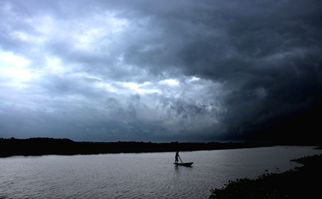 Dark clouds loom over Atri river in Balurghat of West Bengal's Dakshin Dinajpur district on June 16, 2016.