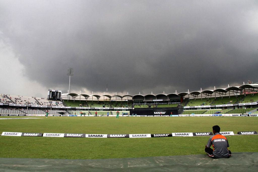 Dark clouds loom over Sher-e-Bangla National Cricket Stadium where the the third One Day International (ODI) match between India and Bangladesh is underway in Dhaka, Bangladesh on June 19, 2014.