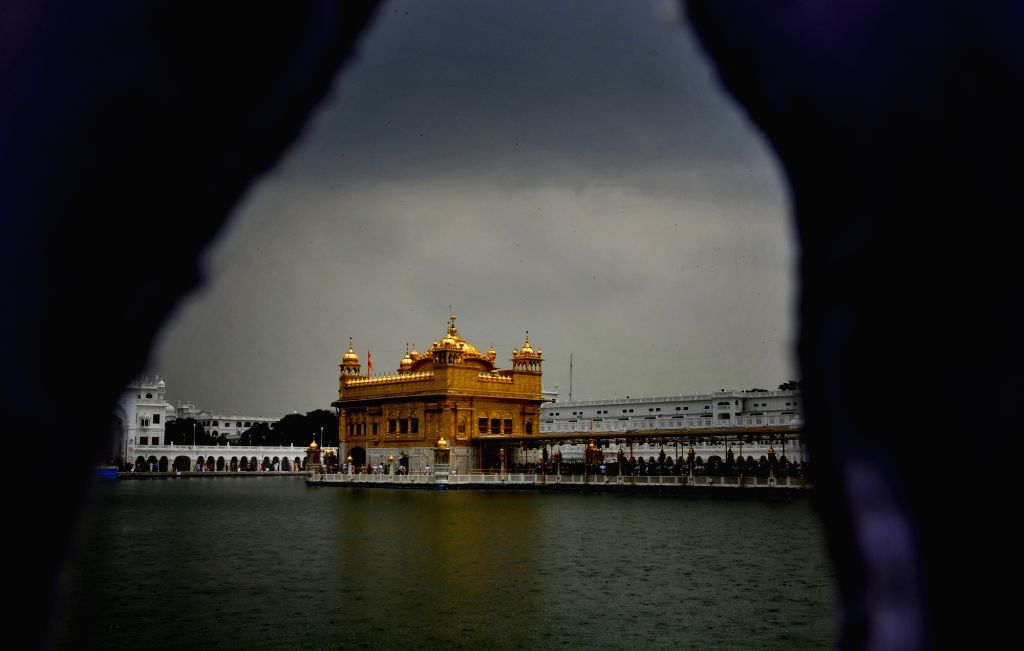 Dark clouds loom over the Golden temple in Amritsar on Aug 4, 2017.