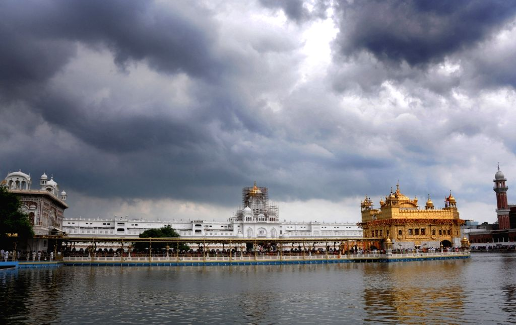 Dark clouds loom over the Golden Temple in Amritsar on Sept 9, 2018.