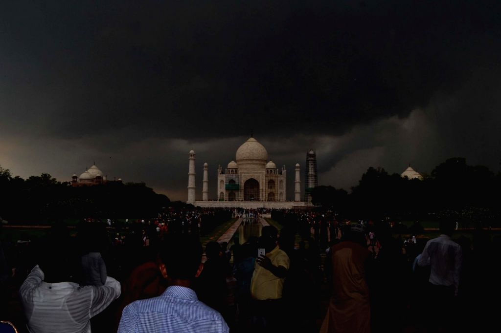 Dark clouds loom over the Taj Mahal in Agra on June 28, 2017.