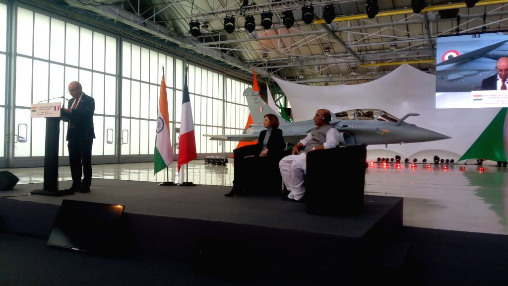 Dassault Aviation Chairman and Chief Executive Officer Eric Trappier addresses during the handover ceremony of the first Indian Air Force Rafale to the Government of India, at Dassault ... - Rajnath Singh