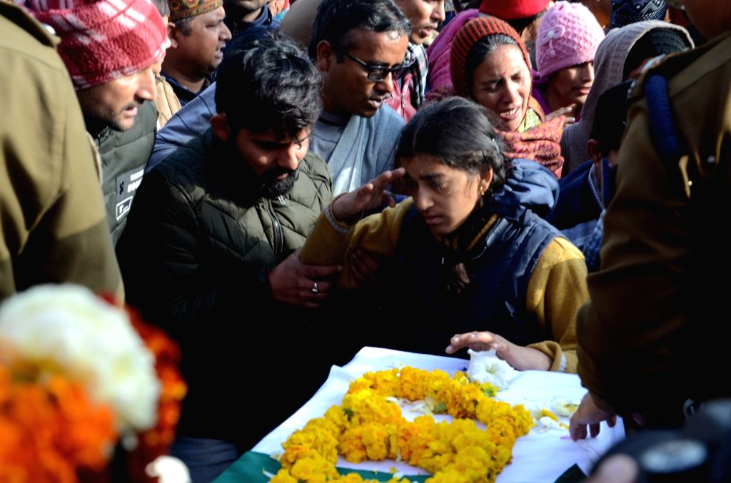Daughter of Mohan Lal, one of the 45 CRPF personnel killed in 14 Feb Pulwama militant attack salutes her father during his last rites in Dehradun on Feb 16, 2019.