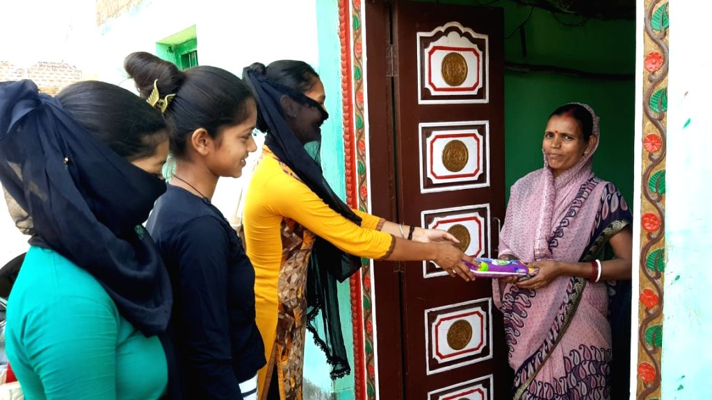 Daughters are teaching menstrual hygiene lessons in Nawada, providing sanitary pads.