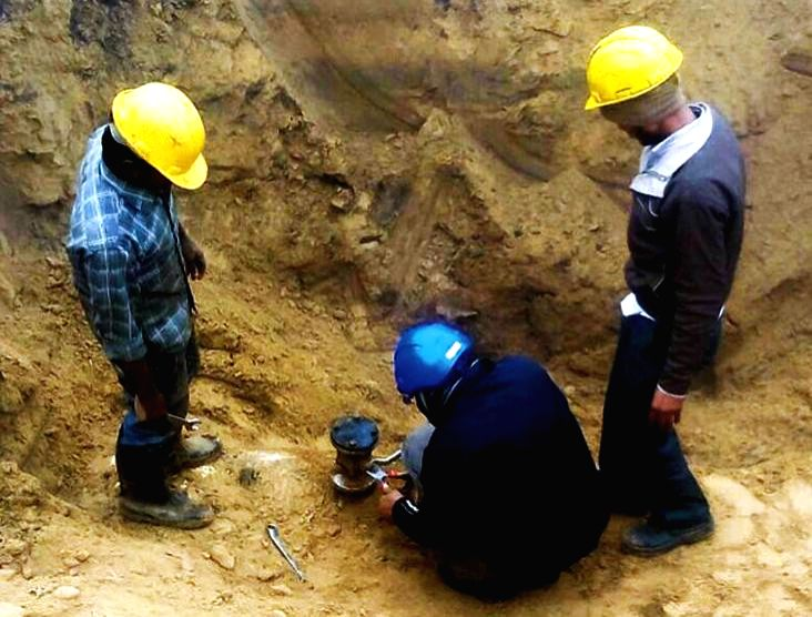 Men busy fixing a leak in Salaya-Mathura IOC pipeline in Dausa district of Rajasthan on Dec 22, 2014.