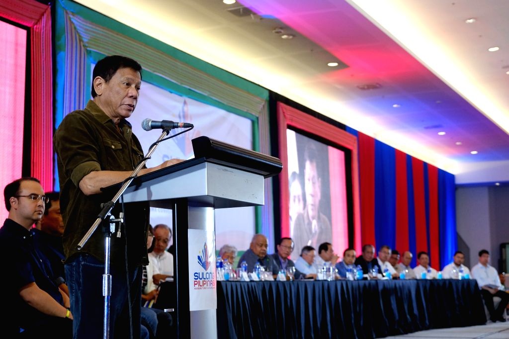 DAVAO CITY, June 22, 2016 - President-elect Rodrigo Duterte speaks during a business forum in Davao City, the Philippines, June 21, 2016. Incoming Philippine President-elect Rodrigo Duterte vowed to ...