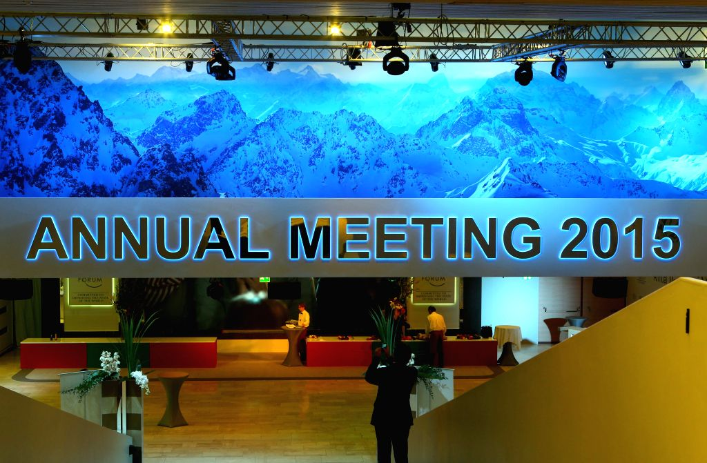 A man takes pictures of the Congress Center of the World Economic Forum (WEF) annual meetings in Davos, Switzerland, Jan. 20, 2015. About 2,500 people from more than .