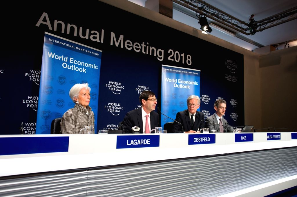 DAVOS, Jan. 22, 2018 - Managing Director of the International Monetary Fund (IMF) Christine Lagarde (1st L) and IMF Economic Counsellor and Director of Research Maurice Obstfeld (2nd L) attend a ...