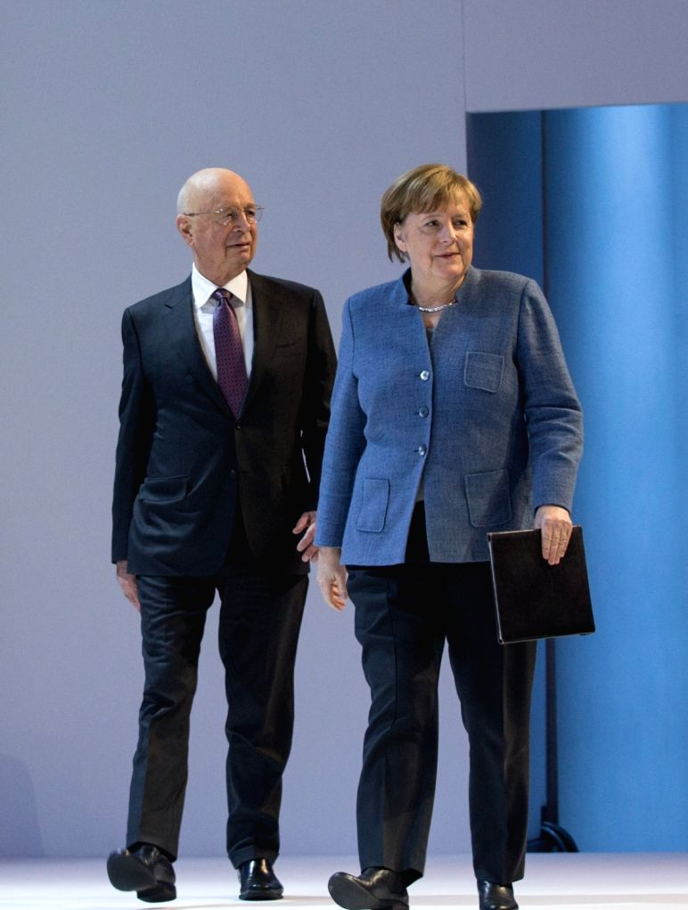 DAVOS, Jan. 24, 2018 - German Chancellor Angela Merkel (R) and Klaus Schwab (R), World Economic Forum (WEF) founder and executive chairman, arrive for a plenary session during the 48th annual meeting ...