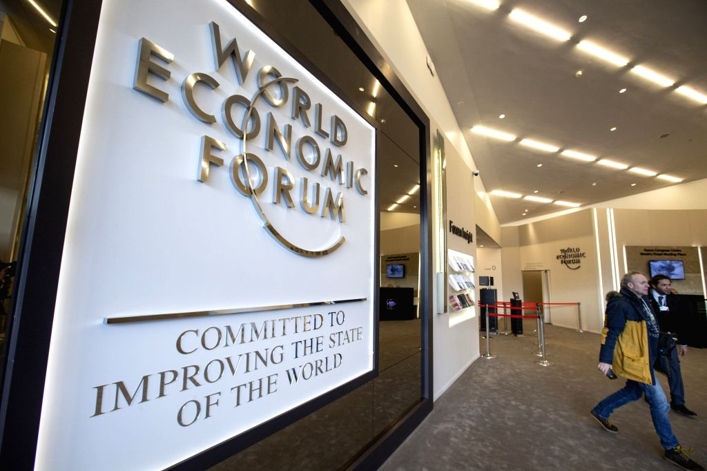 DAVOS (SWITZERLAND), Jan. 21, 2019 People walk by the logo of the World Economic Forum (WEF) in Davos, Switzerland, Jan. 21, 2019. The WEF Annual Meeting will kick off in Davos on Tuesday.