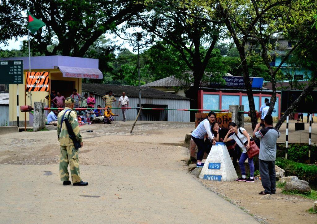 Dawki: Tourists click pictures at Indo-Bangladesh check-post at Dawki in Meghalaya on June 14, 2016. (Photo: IANS)